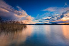Beautiful lake with colorful sunset sky. Tranquil vibrant landscape Stock Photos