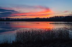 Beautiful lake with colorful sunset sky. Tranquil vibrant landscape Royalty Free Stock Photos