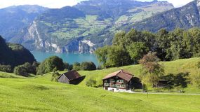 Beautiful lake. Cozy home. Mountain lake in Switzerland Stock Images