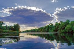 A beautiful lake in Danube Delta, Romania. Discovering Danube Delta in a Canoe. Water channel, river in Danube delta, Romania - Image royalty free stock images