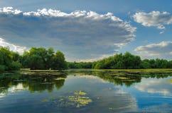 A beautiful lake in Danube Delta, Romania. Discovering Danube Delta in a Canoe. Water channel, river in Danube delta, Romania - Image stock photos