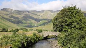 Beautiful Lake District river Mickleden Beck Langdale Valley by Old Dungeon Ghyll Cumbria England United Kingdom UK. By campsite stock video