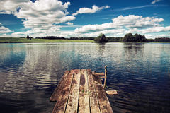 Beautiful lake with diving board for swimming Royalty Free Stock Photos
