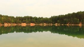 Beautiful lake in the forest stock footage