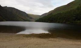 Beautiful lake in the Irish countryside. Lake surrounded by mountains in the beautiful Irish countryside stock photos