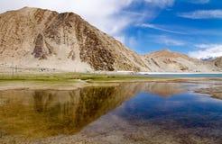Beautiful lake landscape. Beautiful lake near mountain under blue sky Royalty Free Stock Photo