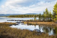 A beautiful lake landscape in Femundsmarka National Park in Norway. Lake with a distant mountains in background. Royalty Free Stock Photo