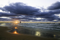 A Beautiful Lake Michigan Sunset. A beautiful sunset under a troubled sky on Lake Michigan Royalty Free Stock Images