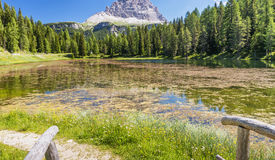 Beautiful lake in the middle of high peaks, Italian Dolomites Stock Photo