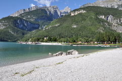 Beautiful Lake, Molveno, Italy. Images shows Molveno Lake at the foot of the Brenta Dolomites in the italien mountains Royalty Free Stock Photo