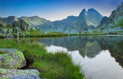 Beautiful lake with mountain reflection in Retezat, Romania. Carpathians Stock Images