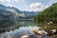 Great lake in the mountains stock photos