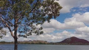 Beautiful lake near to a mountain side and colorful sky royalty free stock photography