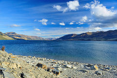 Beautiful lake in New Zealand. Beautiful lake with blue sky in New Zealand royalty free stock photo