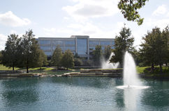 Beautiful lake and office buildings background stock photos