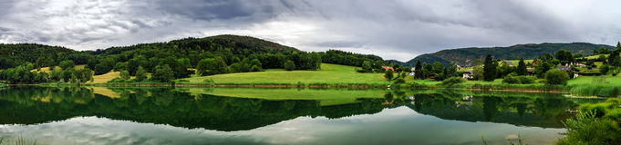 Beautiful lake panoramic view, Alps Royalty Free Stock Images