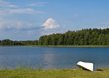 Beautiful lake in Poland. Beautiful lake coast with boat in Poland Stock Photo