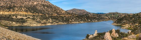 Beautiful Lake Ramona Panorama. Beautiful Lake Ramona surrounded by mountains in an elevated location seen from the Green Valley Truck Trail, Blue Sky Ecological stock photos