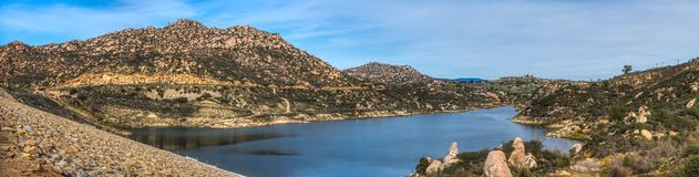 Beautiful Lake Ramona Panorama. Beautiful Lake Ramona surrounded by mountains in an elevated location seen from the Green Valley Truck Trail, Blue Sky Ecological stock photo