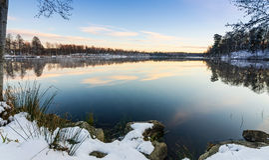 Beautiful lake snowy coast in November Stock Photo