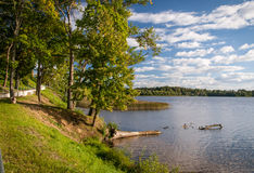 Beautiful lake in summer day Stock Photos
