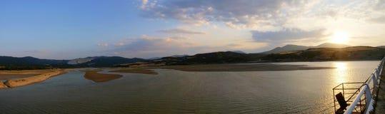 Beautiful lake at sunset. Panoramic view of beautiful lake at sunset stock photo