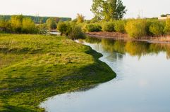 Beautiful lake surrounded by green grass.Lake in nature.Outfoor stock images