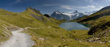 Beautiful lake in the Swiss Alps. Beautiful lake with mountain in the Swiss Alps snow, and highest summits, panoramic view royalty free stock image