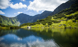 A beautiful lake in Tatry mountains, Slovakia. Mountain landscape in a sunny day stock photo