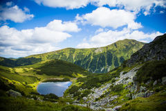A beautiful lake in Tatry mountains, Slovakia. Mountain landscape in a sunny day stock photography