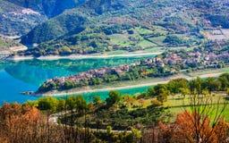 Beautiful lake Turano and village Colle di tora. Rieti province, Royalty Free Stock Photo