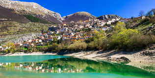 Beautiful lakes of Italy- Lago di Barrea and medieval village i Royalty Free Stock Images