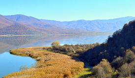 Beautiful lakeshore. A beautiful shore of the small Prespa lake in Greece early in winter Royalty Free Stock Images