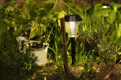 Beautiful lamp in the garden. Lamp with solar battery royalty free stock image