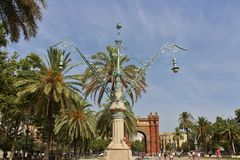 Beautiful lamp posts at Arc de Triomf, Barcelona. The Barcelona Arc de Triomphe was built for the 1888 World Expo as a symbol to welcome all visitors from all Stock Image