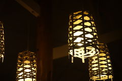 Beautiful lamp shades in restaurant. Lamp shades in a restaurant hanging from roof Stock Photos