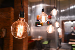 Beautiful lamps on ceiling in restaurant. Royalty Free Stock Photos