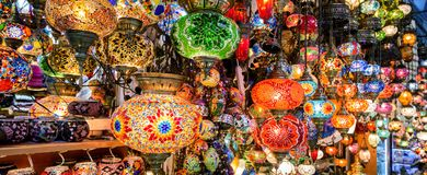 Beautiful lamps in Grand Bazaar, Istanbul, Turkey. Panoramic view of colorful oriental gifts. Stained glass lamps in artisan market close-up. Arab and Turkish royalty free stock image