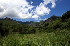 Beautiful Landscape. View of the Drakensberg Mountains and the rolling green hills at its feet Stock Images