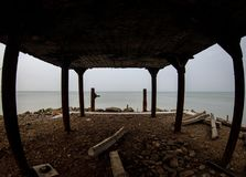 Beautiful landscape of abandoned house on rocky seashore at sunset time. Cloudy weather. Caspian Sea, Azerbaijan. Novkhani royalty free stock images