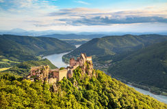 Beautiful landscape with Aggstein castle ruin and Danube river in Wachau, Austria. Beautiful landscape with Aggstein castle ruin and Danube river at sunset in Stock Photo