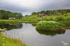 Free Beautiful Landscape Along With Waters Edge, With A Village & Mountains In The Background, Saltstraumen, Bodo, Nordland, Norway. Royalty Free Stock Photography - 210004537