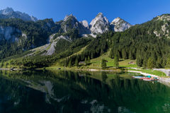 Beautiful landscape of alpine lake with crystal clear green water and mountains in background, Gosausee, Austria Stock Images