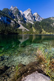 Beautiful landscape of alpine lake with crystal clear green water and mountains in background, Gosausee, Austria Royalty Free Stock Photography