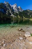 Beautiful landscape of alpine lake with crystal clear green water and mountains in background, Gosausee, Austria Stock Photography