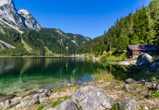 Beautiful landscape of alpine lake with crystal clear green water and mountains in background, Gosausee, Austria Stock Photo