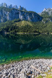 Beautiful landscape of alpine lake with crystal clear green water and mountains in background, Gosausee, Austria Stock Photos