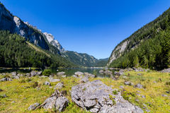 Beautiful landscape of alpine lake with crystal clear green water and mountains in background, Gosausee, Austria Royalty Free Stock Images