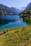 Beautiful landscape of alpine lake with crystal clear green water and mountains in background, Gosausee, Austria Royalty Free Stock Image