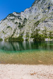 Beautiful landscape of alpine lake with crystal clear green water and mountains in background, Obersee, Germany.  Royalty Free Stock Photos
